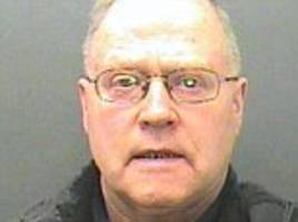 Grammar school teacher who took pupils on trips to youth hostels so he could abuse young boys is jailed for three years