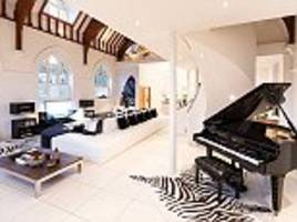 Church that was built when Queen Victoria was on the throne is converted into luxurious home by Brazilian interior designer - and the organ has been replaced by a piano that plays itself