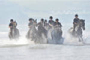 Army's top equestrians ride through surf and sun at Woolacombe
