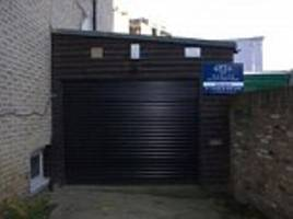 Is this Britain's most expensive garage? Tiny lock-up workshop in Kensington goes on sale for £650,000... the same price as an eight-bedroom farmhouse in Northumberland
