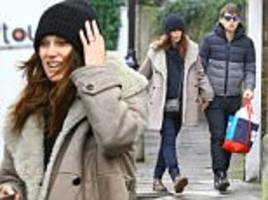 Keira Knightley looks happy to be back to normality with James Righton in London