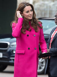 Pregnant Kate Middleton gives first hint she's expecting baby girl as she makes final appearance before giving birth