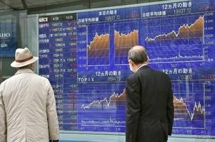 Asian stocks largely higher after Wall Street hits record
