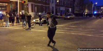 Video: Man Dances to Michael Jackson's 'Beat It' During Baltimore Riots
