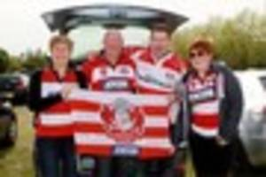 Devoted Gloucester Rugby fans make their way to the Stoop for...
